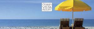 beach chairs with yellow beach umbrella