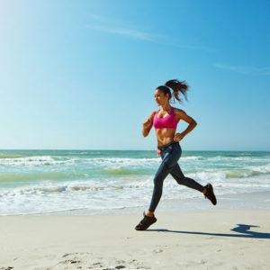 woamn running on the beach